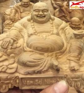Tượng gỗ taplo Phật Di Lặc gỗ Bách Xanh
